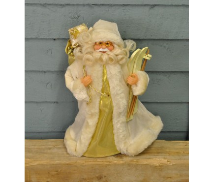 Santa with Skis Christmas Tree Topper in Cream